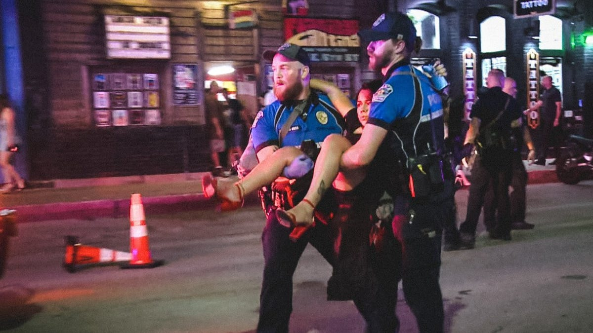 One of Two Suspects Arrested in Austin Shooting That Left 14 People Injured