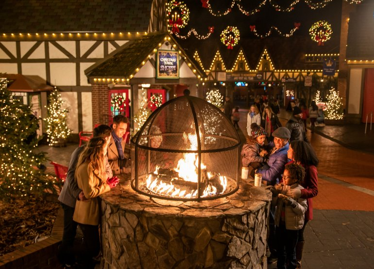 warming by the fire at Busch Gardens Christmas Town