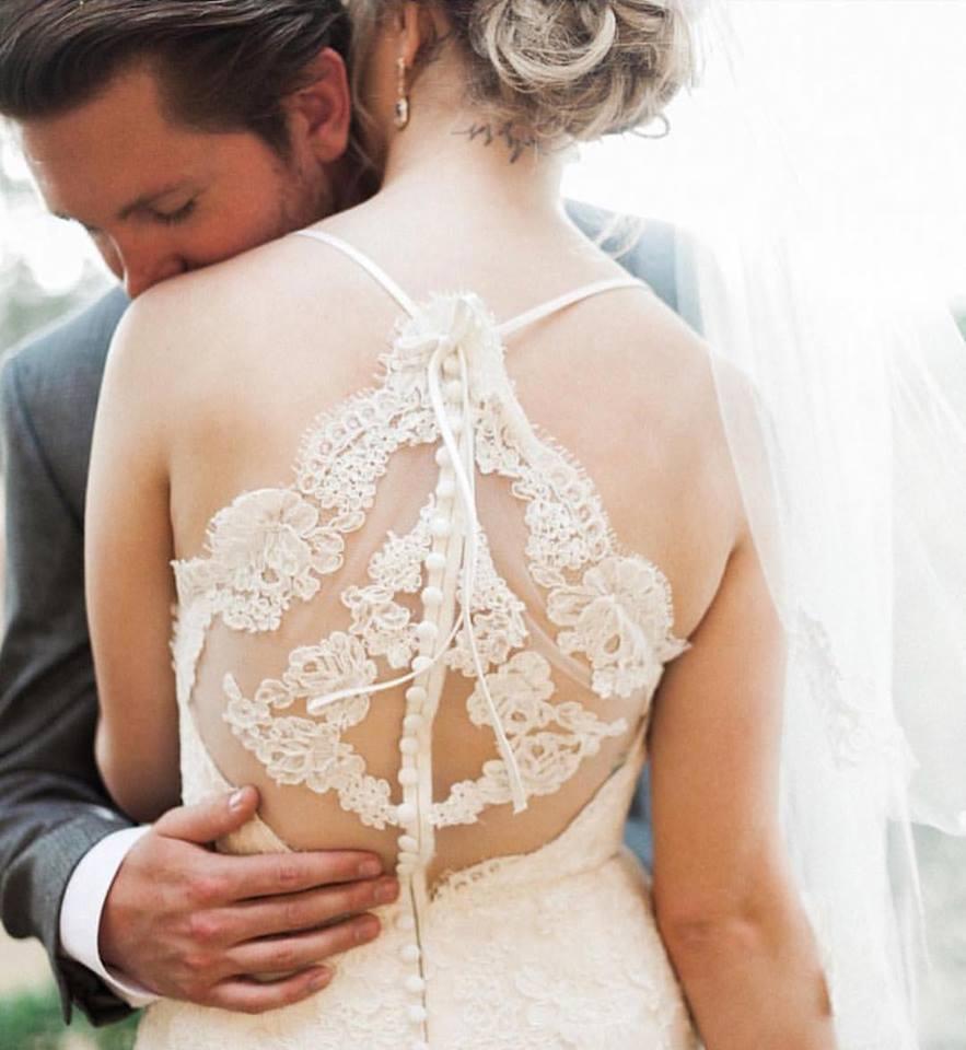woman in illusion back wedding dress
