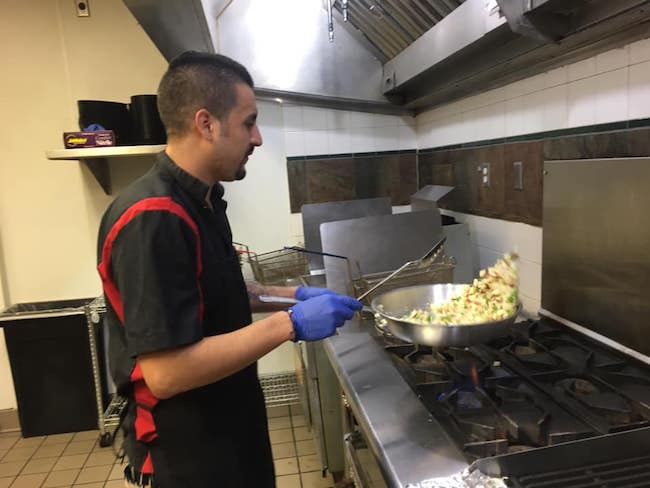man working in restaurant in denver