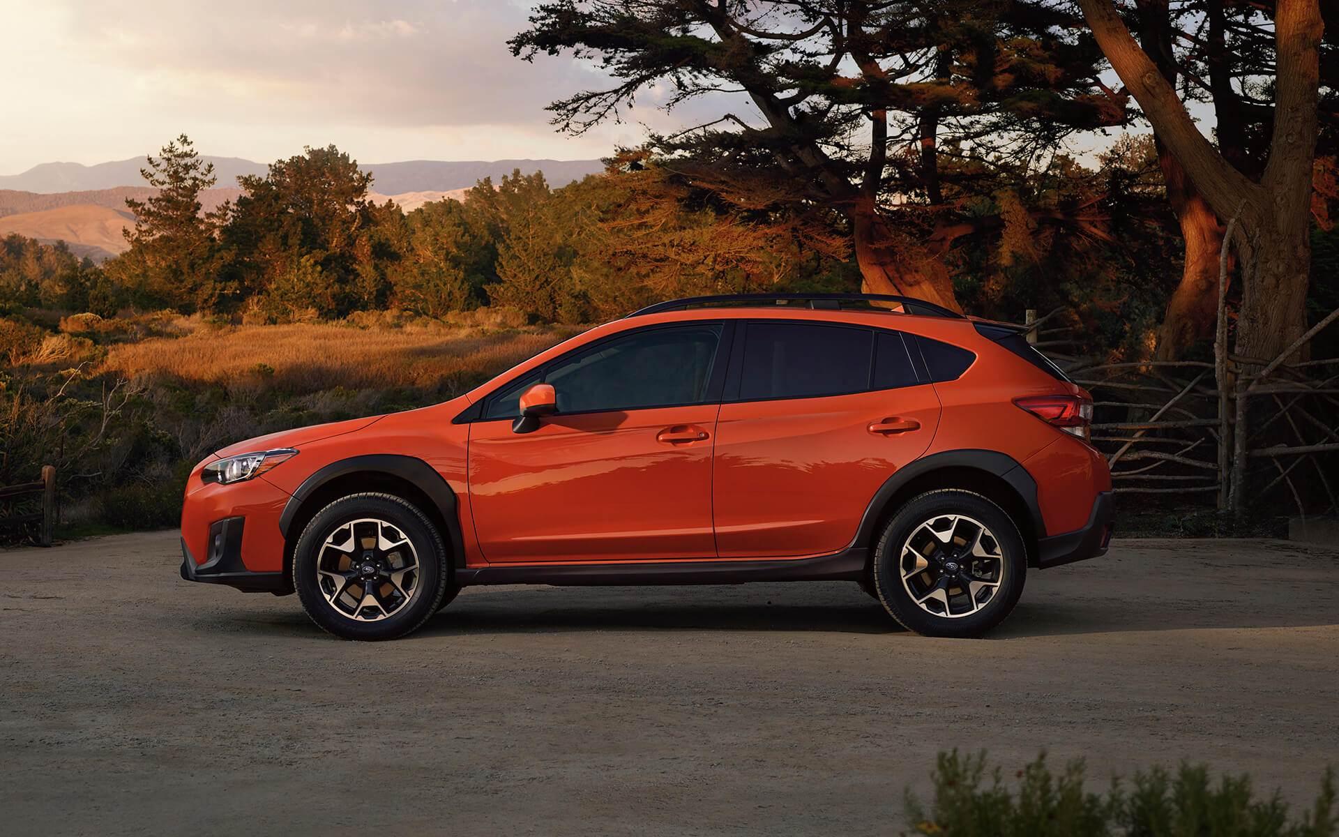 Bright orange Subaru Crosstrek sunset photo