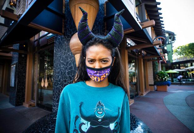 Girl wearing Maleficent horn headband and an Ursula shirt