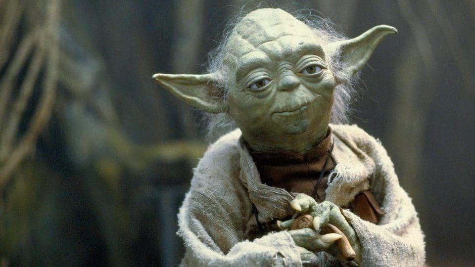 Yoda leans on a stick