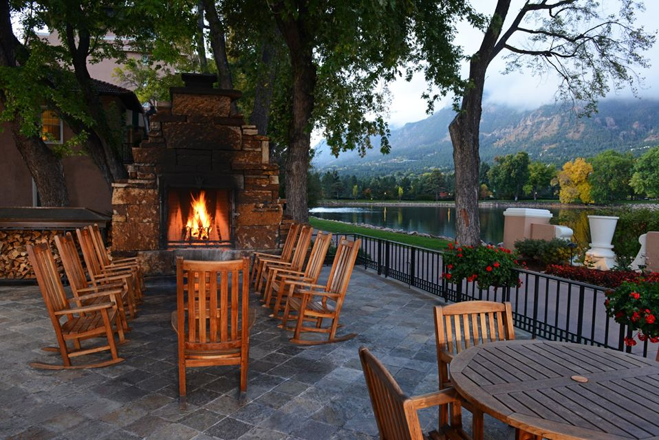 fireplace, rocking chairs, mountain view
