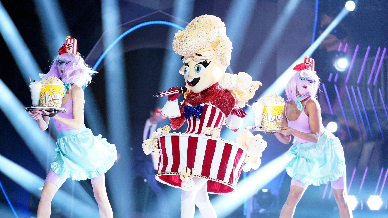 Popcorn masked singer singing on stage
