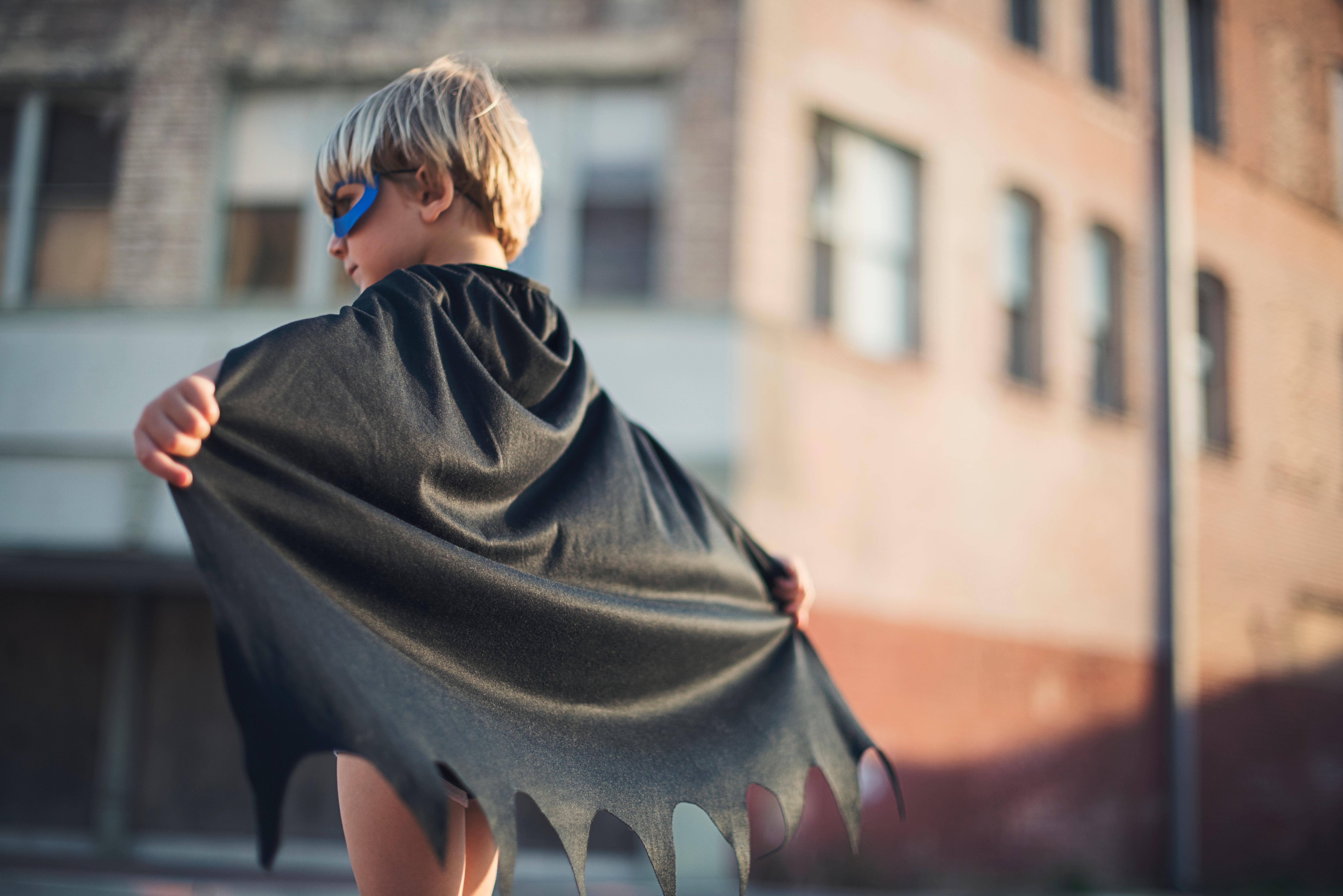 kid wearing a cape
