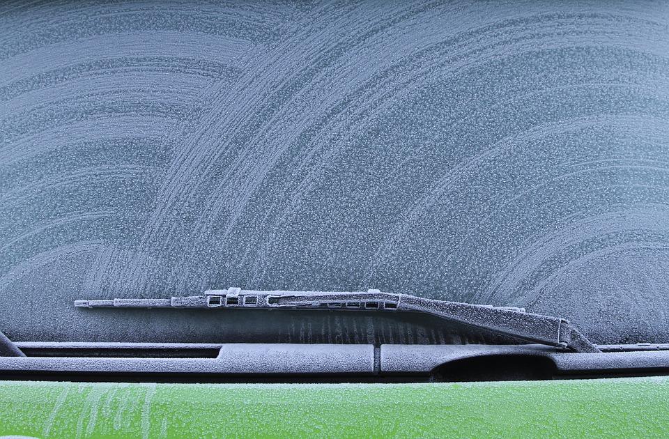windshield wipers on frosty window