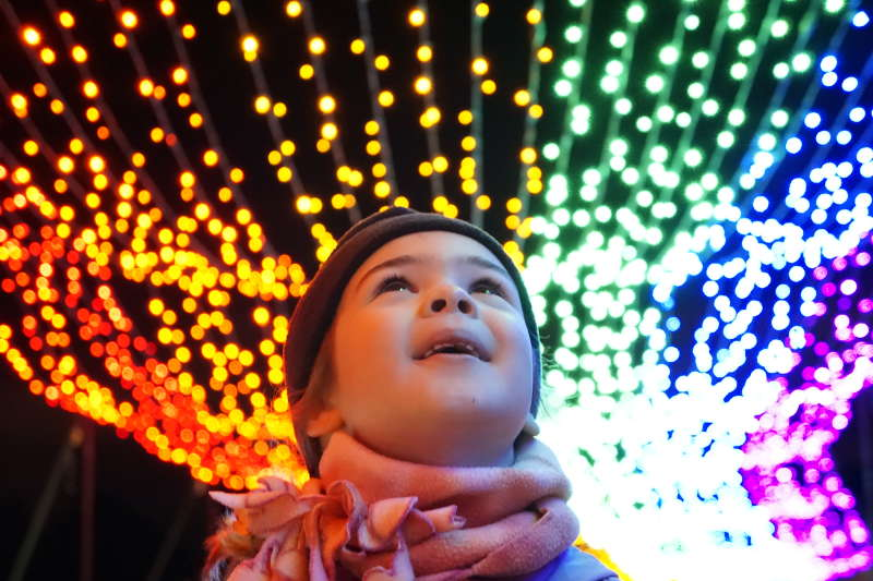 Little girl in front of lights