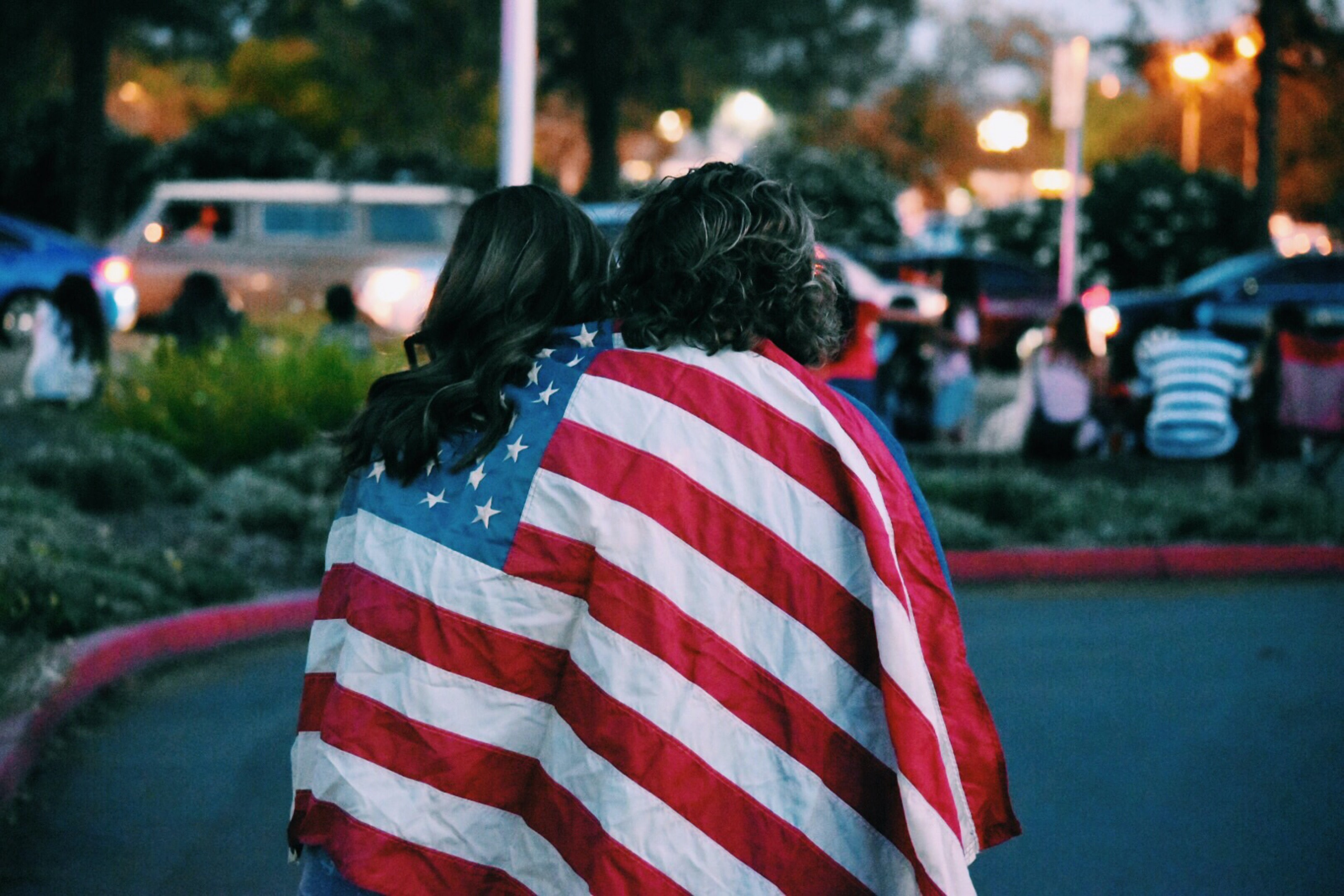 people wearing a flag