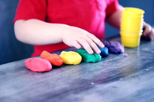 child playing with clay