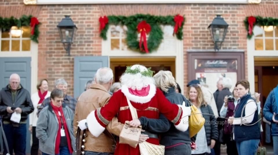 Santa Hugging People
