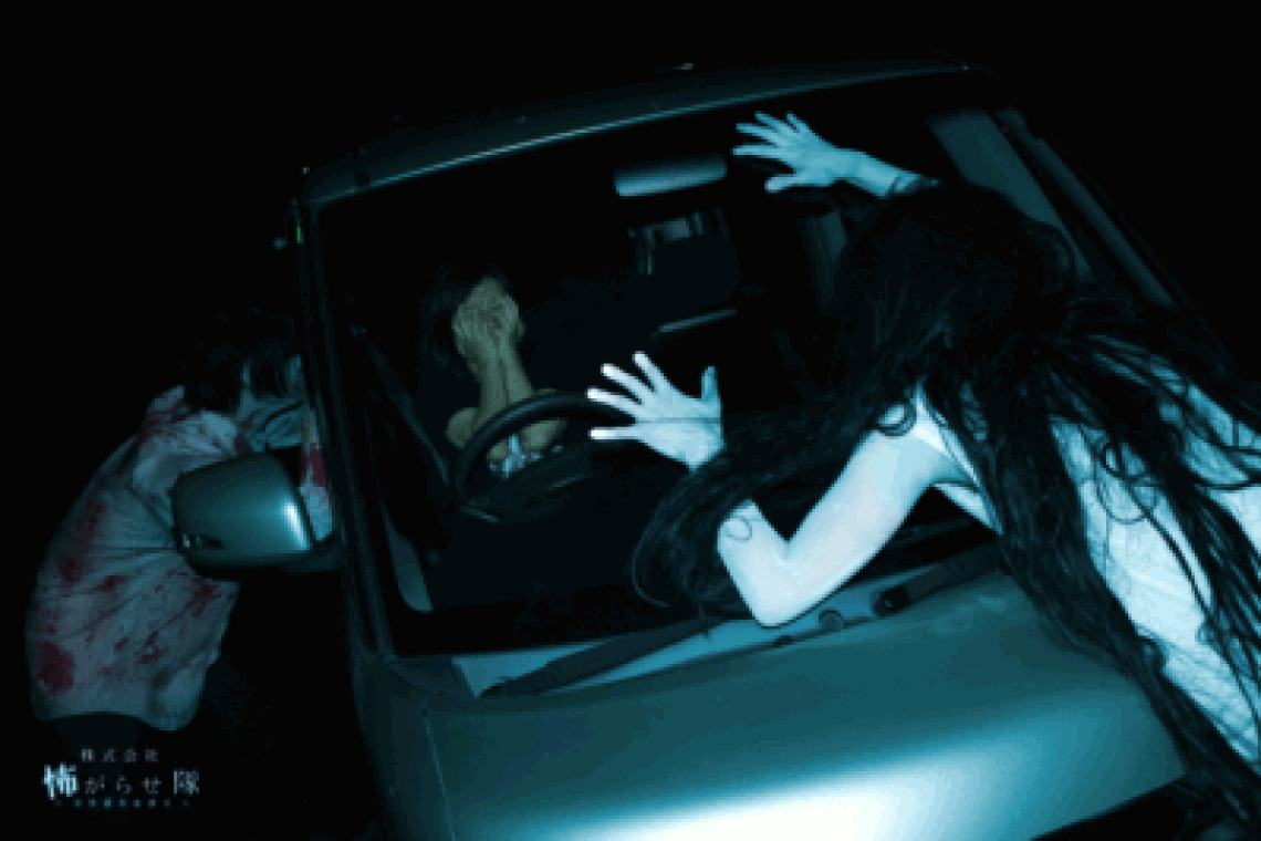Horror actors on a car window