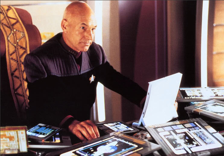 Captain Picard at desk with computers