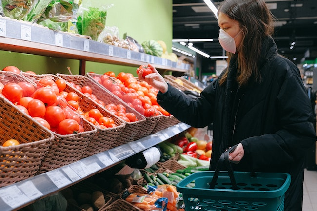 Woman shopping wearing mask
