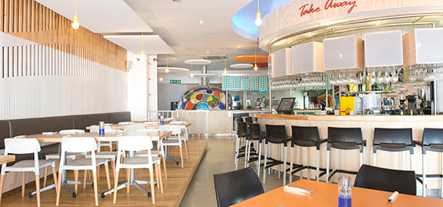 Modern Italian Kitchen is an airy eatery, which serves wood-fired pizza, pasta and dessert and also features a terrace and a playground. It offers take-away as well.