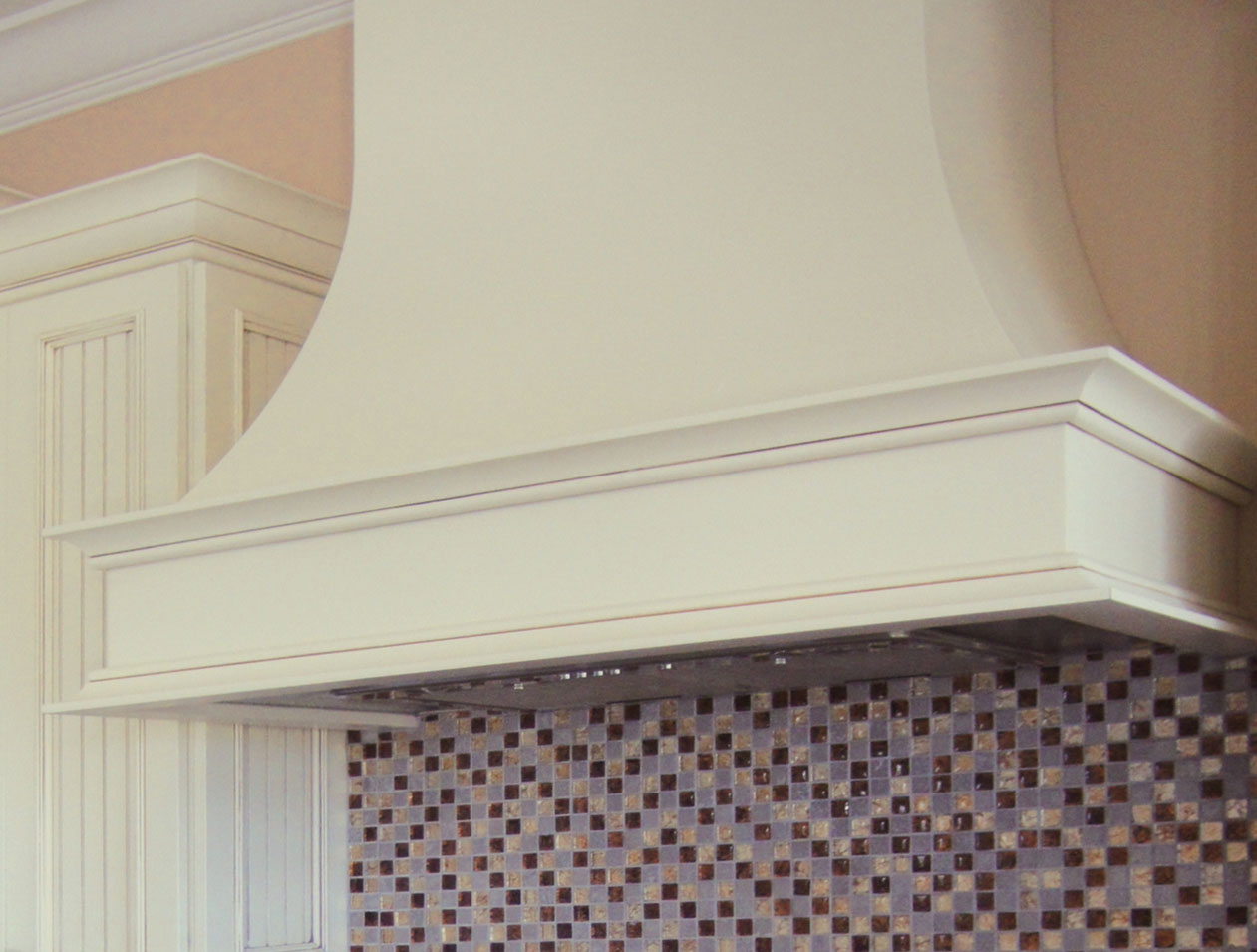 White curved contemporary wood range hood