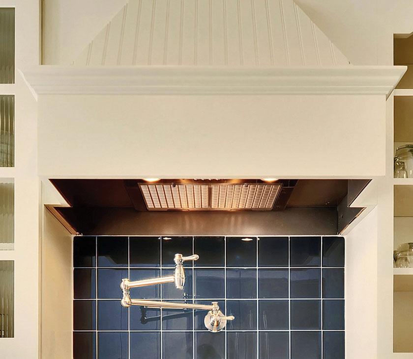 Cream beaded integral wood range hood cabinet