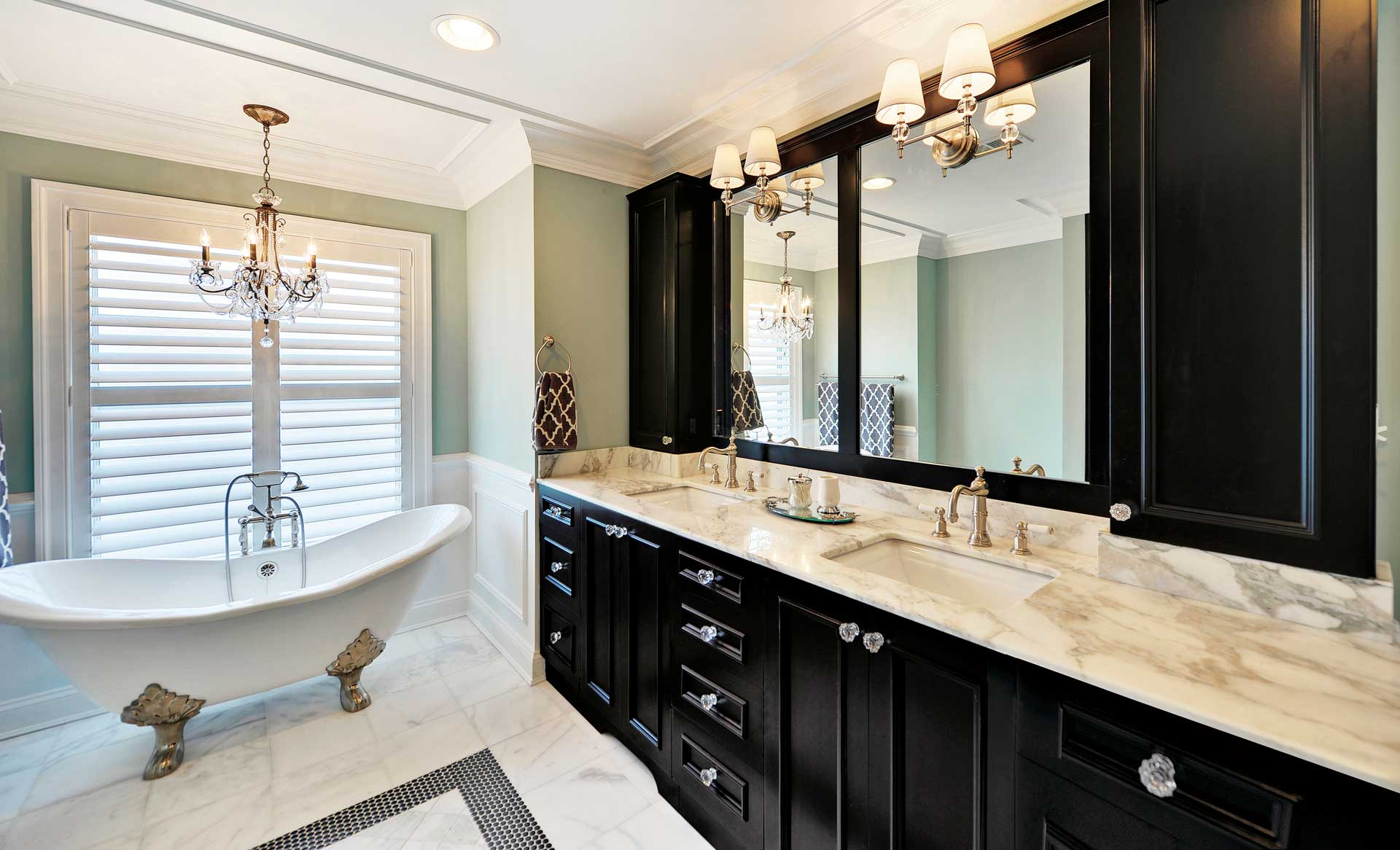 This stunning full access frameless Melrose Maple, Onyx (black) painted two sink bathroom vanity is designed with semi-custom Aspire cabinetry.