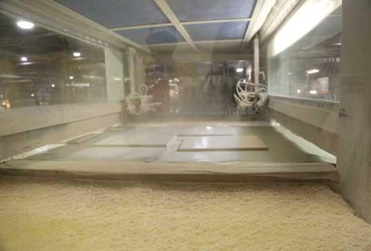Door being sprayed in machine
