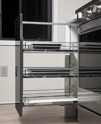 Base Spice Rack Cabinet with stainless rails installed beside a stove
