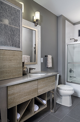 The 2nd Bathroom Vanity and linen cabinet are Bel-Air, Putty Oak, Heavy Texture Melamine and a Fresno stainless door frame with Wisp Silver Resin installed.