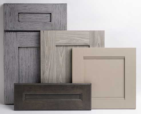 Photo showing 3 Melamine cabinet doors with 5-Piece construction. Also show 1 5-piece drawer head