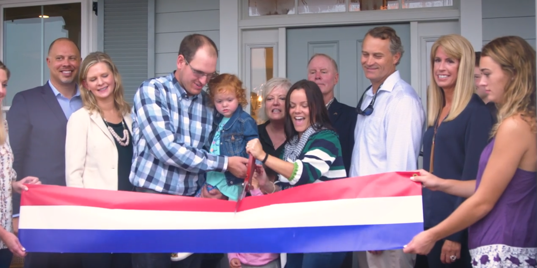 Brooking family cutting the ribbon on their new home!