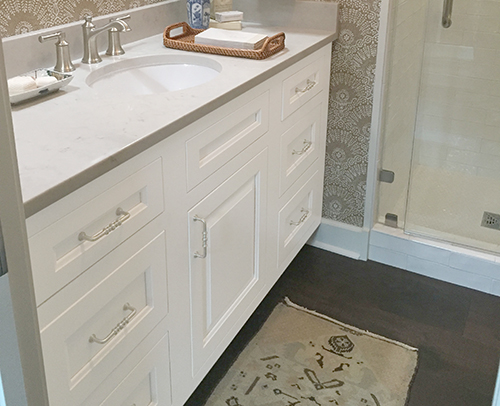 The Guest bathroom features a Glacier White painted vanity with 6 drawers.