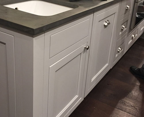 The Island has a matching end panel with door style appearance option and a Dishwasher base cabinet sports a dishwasher front