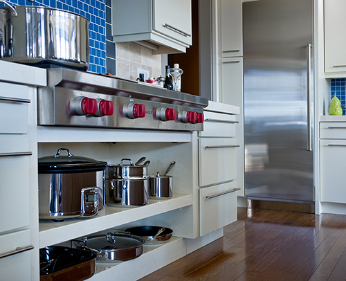 Kitchen cabinets are Midtown, Gloss Graphite with a Matching Edge and Gray interior.