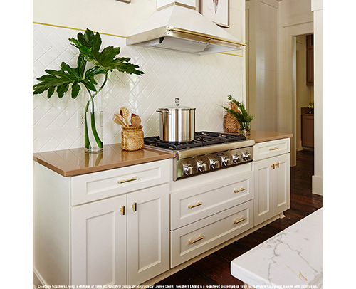 Kitchen base cabinets in a Divinity, off-white painted finish