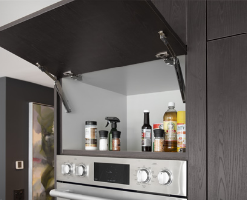 KITCHEN<br> A Vertical Lift cabinet allows for easy storage in hard-to-reach cabinets above kitchen hoods and oven cabinets.