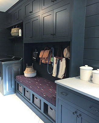 Photo of the Wellborn�s Bleu (Blue) cabinetry in the Mudroom area of Laundry room. Featuring bench seating, baskets and hooks for hanging items.