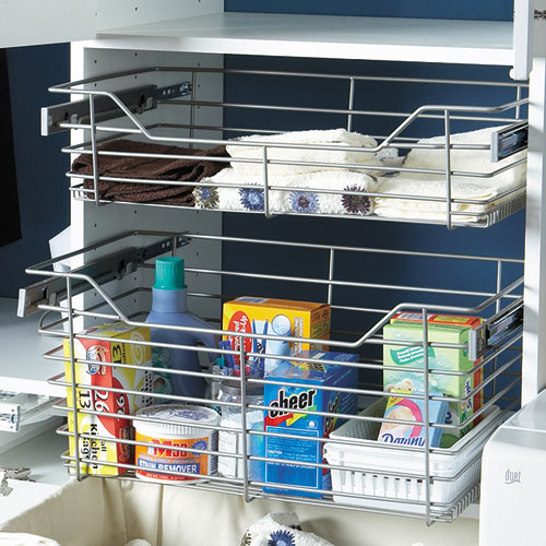 Pullout baskets storing laundry supplies and folded clothing