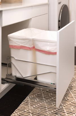 LAUNDRY ROOM<br> Wastebaskets are wonderful in the laundry room especially when put in a place that is easily hidden and accessible.