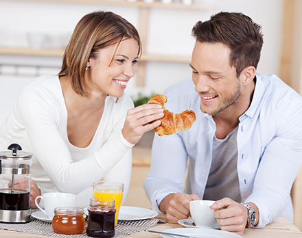 Man and Woman enjoying breakfast at their new kitchen Island