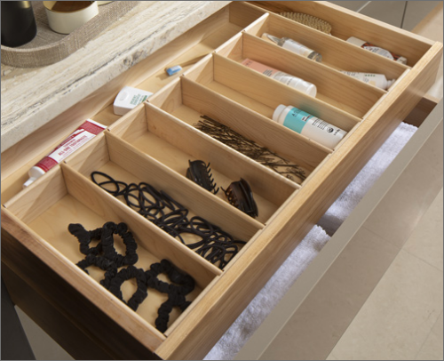 MASTER BATH <br>This drawer base cabinet contains a hidden drawer, allowing for storage and organization of hair care items.