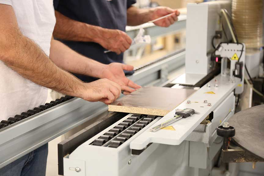 Employee readying board for Edge banding