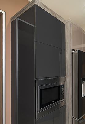 High Microwave Cabinet with a Double Vertical Hinge Cabinet Door. Touch to Open is installed for easy access.