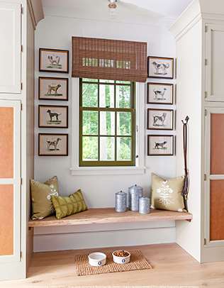 Mudroom cabinetry features warm faux leather panels