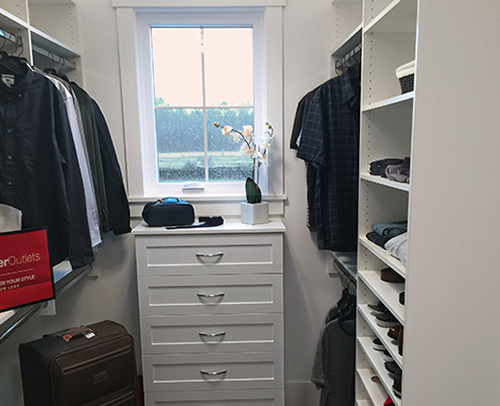 Jeremy's closet shelving and chest of drawer provides maximum storage space