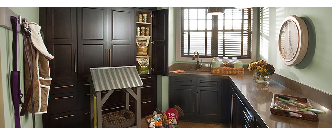 Laundry Room Pet Suite with Stained Wood Cabinets