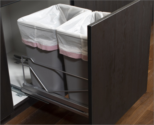 PANTRY<br> A wastebasket cabinet is a perfect solution for hiding trash in an elegant manner.