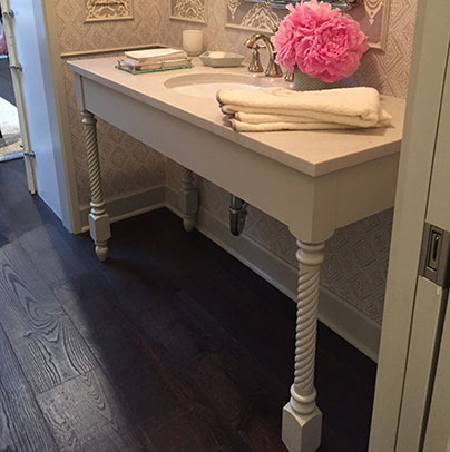 The powder bath vanity is finished in a Sherwin Williams Repose Gray paint. The vanity�s beautiful Rope Legs add elegance to the vanity design.