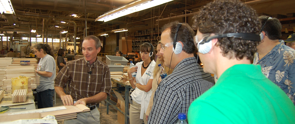 Photo of a Plant tour— John Wellborn is showing them how a door is assembled in the door department