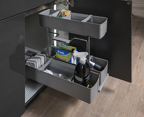 Under Sink Caddy Pullout installed in kitchen cabinet.