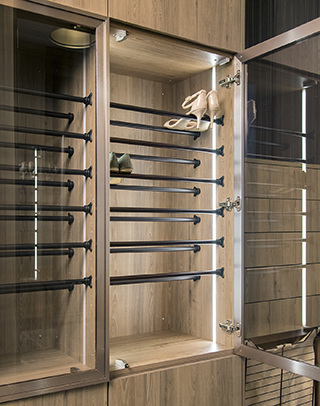 His and her shoe storage cabinets with glass doors