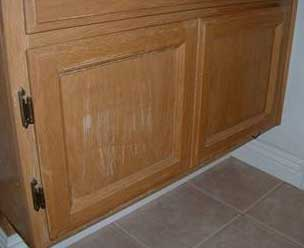 Photo show damage done to cabinets due to being cleaned improperly.