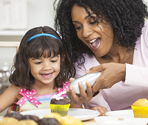Mom and Daughter having fun while cooking together in their kitchen