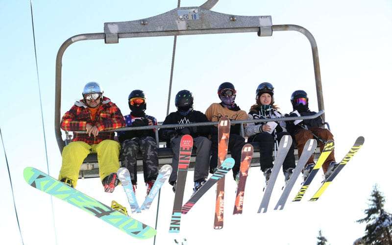 Skiers and Snowboarders on Chairlift